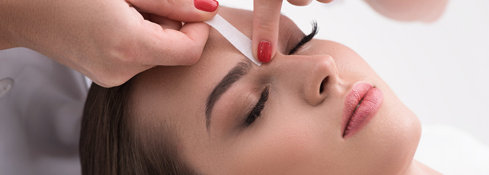 Woman getting her eyebrows waxed